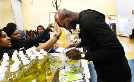 Mattapan, MA-February 11, 2012-Globe Staff photo by Stan Grossfeld====Celtics Kevin Garnett lets Mattapan community members mop his brow as he gives away food and other items at the Mildred Avenue Community Center in Mattapan as part of Celtic Keyon Dooling's Gametyme Foundation. Five Celtics players distributed $20,000 worth of fod and personal items at two iner city locations.